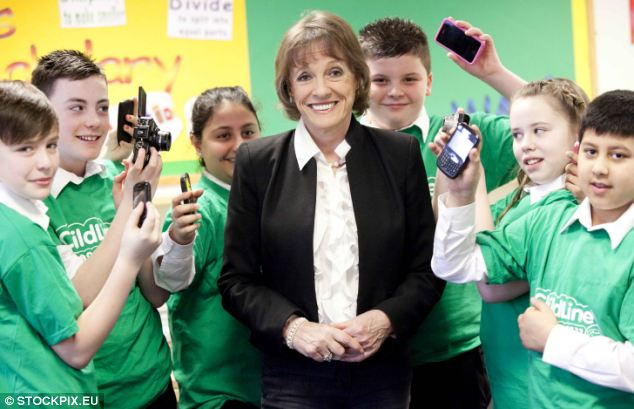 Disgusted: Esther Rantzen with youngsters at a Childline event