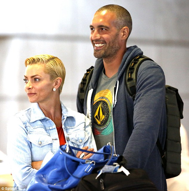 Jaime Pressly And Boyfriend Hamzi Hijazi Land At LAX After