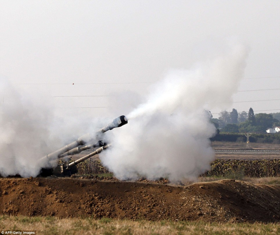 An Israeli artillery fires a 155mm shell towards targets in the Gaza Strip from their position near Israel's border with the Strip