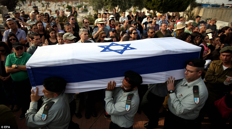 Victim: The coffin of killed Israeli soldier Amotz Greenberg at his funeral in the cemetery of Hod Hasharon in Israel