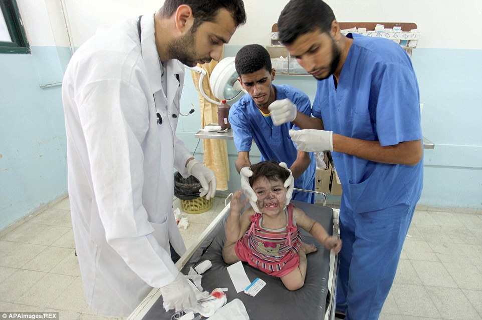 "Mandatory Credit: Photo by APAimages/REX (3960200b)<br /><br /><br /><br />  A Palestinian girl from al-Shaer family, who medics said was wounded after an Israeli air strike hit their house, receives treatment at a hospital in Khan Younis in the southern Gaza Strip<br /><br /><br /><br />  Israel - Gaza conflict, Gaza, Palestinian Territories - 20 Jul 2014<br /><br /><br /><br />  The death toll in Gaza passed 400 as Israel pressed its biggest offensive in the enclave in five years, Palestinian health officials said. ""410 people have been killed since the war started and more than 3,020 people have been injured, most of them civilians,"" deputy health minister Yussef Abu Rish told reporters at al-Shifa hospital in Gaza City"