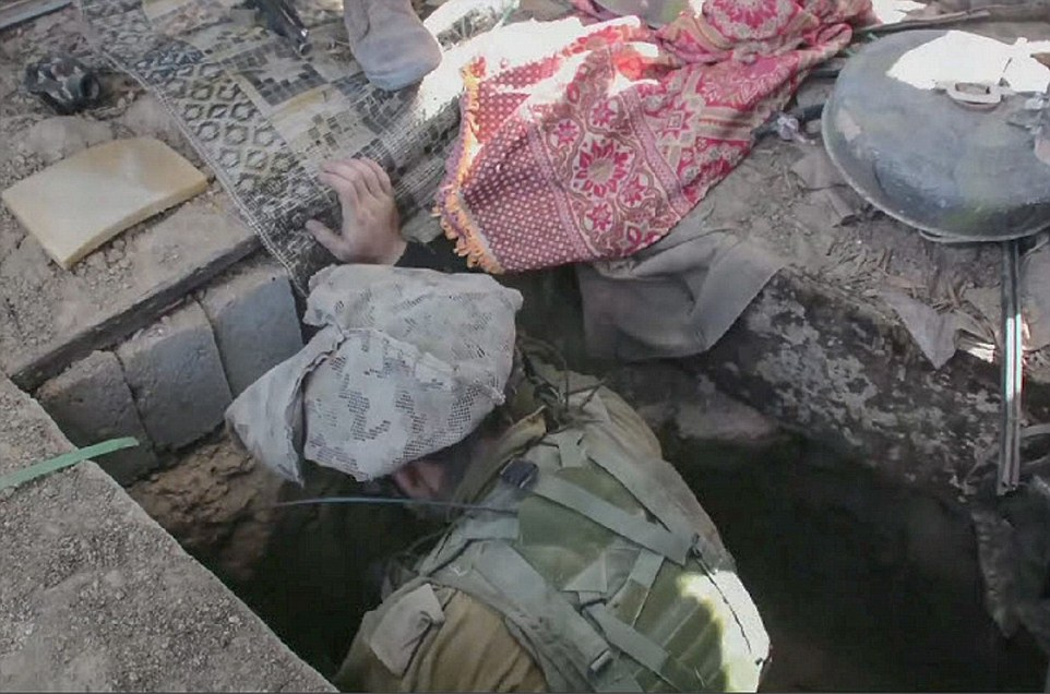 Israeli forces move into the tunnel to plant explosives after the it was spotted by an aircraft