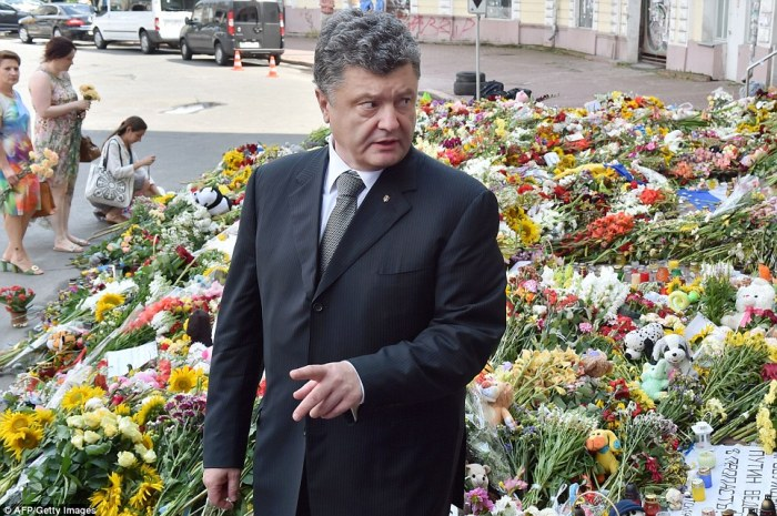 Tributes: Ukrainian President Petro Poroshenko today left flowers outside the Dutch embassy in Kiev