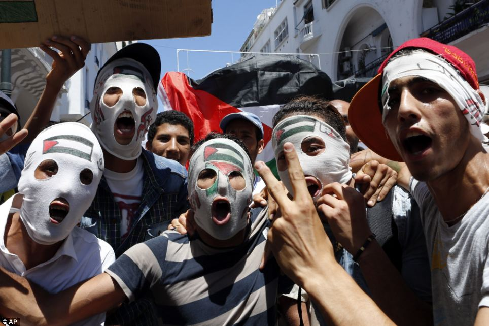 Protest: Moroccans activists shout slogans, in Rabat, Morocco, yesterday during a demonstration to protest against the Israeli army's shelling in the Gaza strip