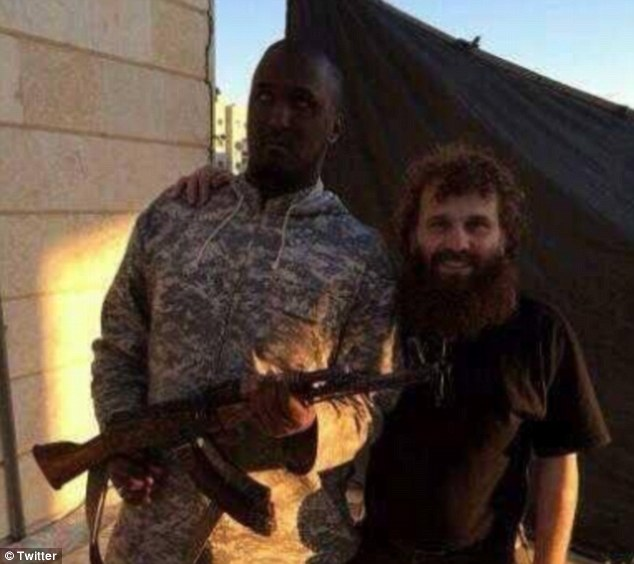 Pose: Taymullah al-Somali is a Dutch national who is believed to have travelled to the Middle East earlier this year. He has been photographed numerous times alongside ISIS militants