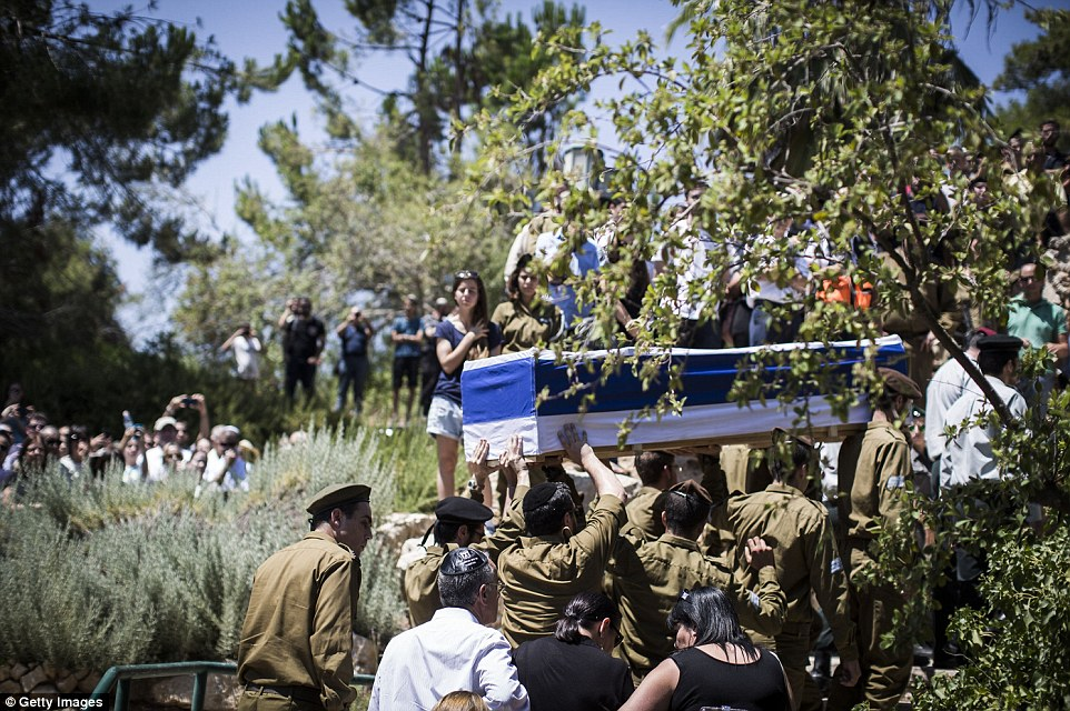 Soldiers carry the coffin of Sergeant Max Steinberg during his funeral today in Israel