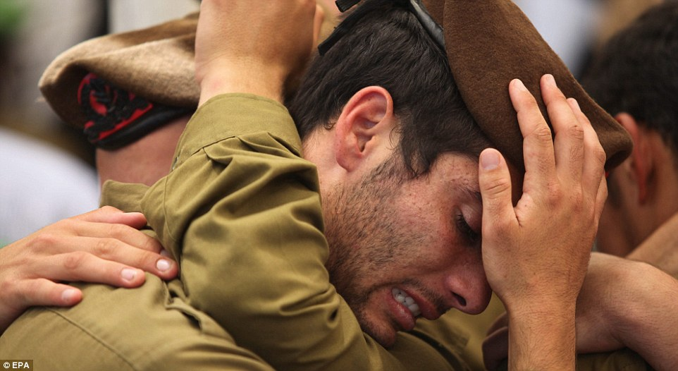 Tens of thousands of people attended the funeral of Max Steinberg the 'lone soldier' who left the US and volunteered to join the Israel Defense Force and died fighting in the Gaza Strip