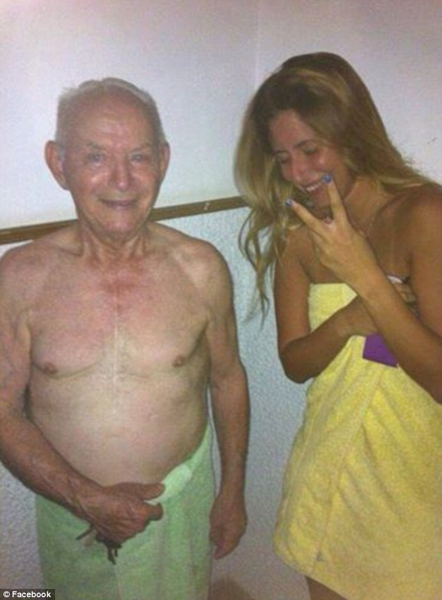 In one snap a young woman is shown standing next to an elderly man in his towel with the caption 'Meet other neighbours in the shelter'