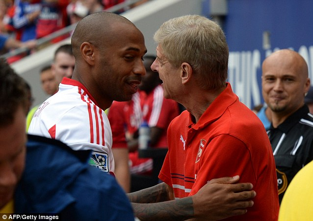 Old friends: Thierry Henry embraces Arsene Wenger