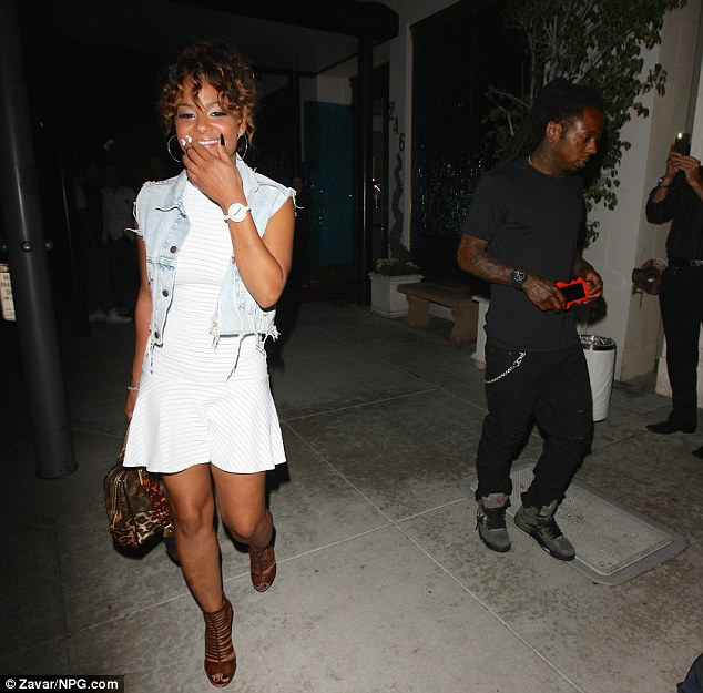 Just friends? The pair claim they are working together not dating, but the RNB songstress looked like she had something to hide as she emerged giggling
