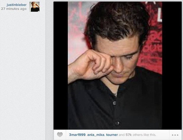 A low blow: Justin Bieber posted this image of a crying Orlando Bloom on Wednesday, just after an altercation with the actor outside Cipriana restaurant in Ibiza, Spain; it is widely believed the two don't get along because the 20-year-song got too close to the 37-year-old actor's wife Miranda Kerr