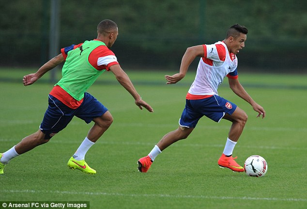 On the ball: Sanchez (right) could face Benfica on Saturday at the Emirates Cup after proving his fitness