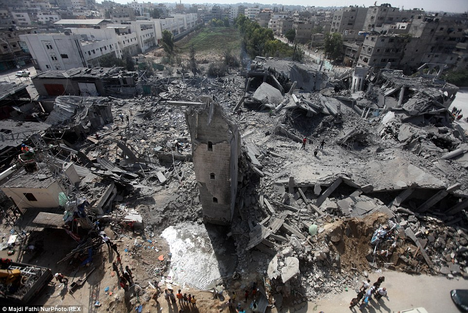 Tower: Residents gathered at the ruins of the mosque, which the Israeli military said was singled out for bombing because it had been used to store weapons