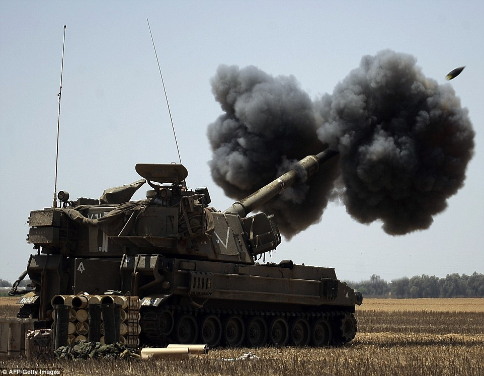 Bombs away: An Israeli artillery fires a 155mm shell towards targets in the Gaza Strip from their position near Israel's border with the Palestinian enclave today