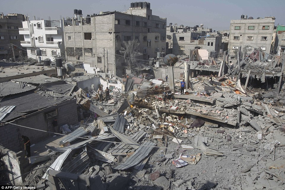 Pictured: Damage in Rafah. The U.S. backs Israel in its pledge to continue searching for Hamas tunnels under the border even when official ceasefires are declared