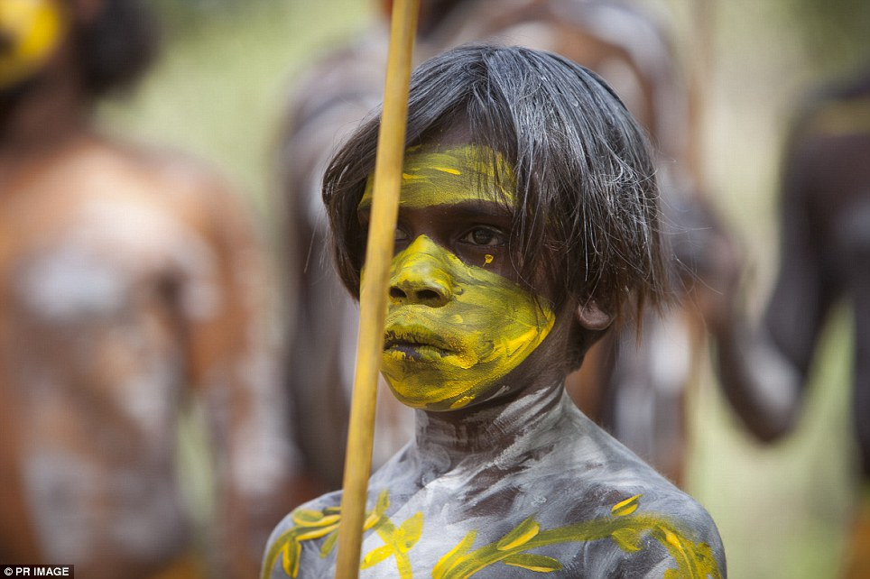 A Gumatj boy watches on at the official opening of the new Garma Knowledge Centre on Friday