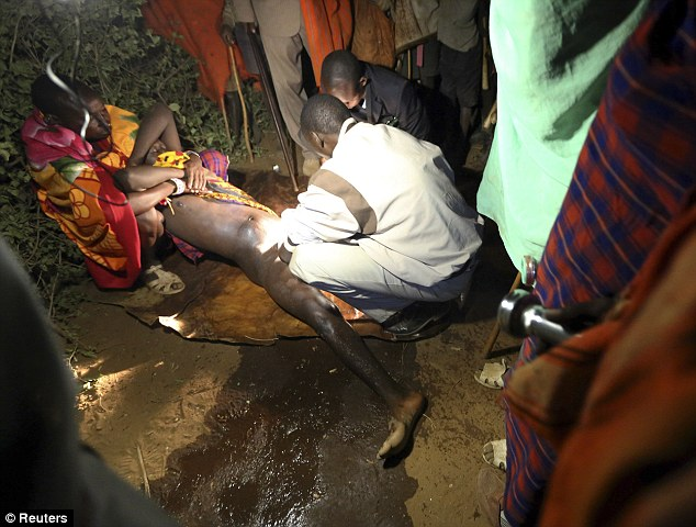 A dozen men have been forced to undergo circumcisions in western Kenya. File picture shows a male Masai as he is circumcised by a nurse during an initiation ceremony in the village of Eremit in 2012