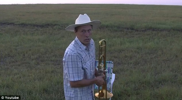 Novel idea: Herding cattle has never been so easy for one farmer thanks to his trombone-playing skills