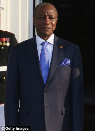 Alpha Conde - another leader with a dubious governance record - pictured arriving at the event held at the White House