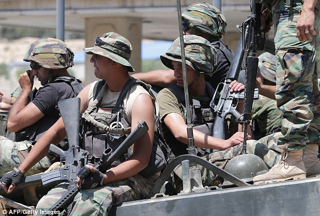Reprisals: Members of the Lebanese army patrol near Arsal earlier this week