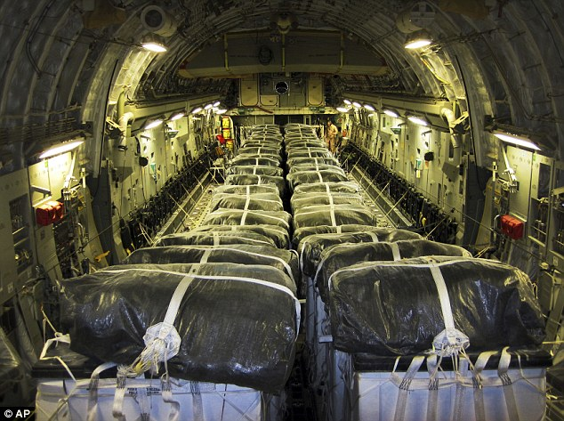 Aid: Pallets of bottled water are loaded into a USAF C-17 in readiness for an humanitarian airdrop in Iraq