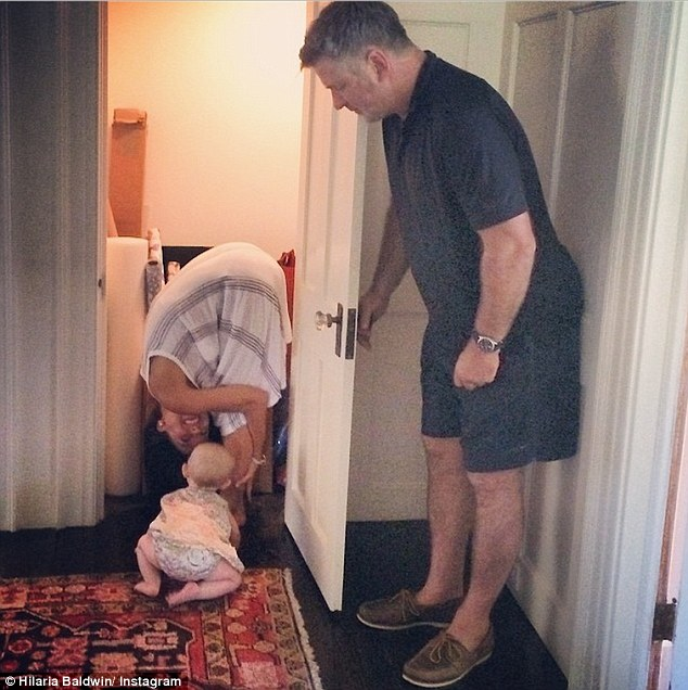 And so it continues: Hilaria also posted this yoga pose on Saturday in which her baby girl Carmen found her in a closet with the help of Alec Baldwin