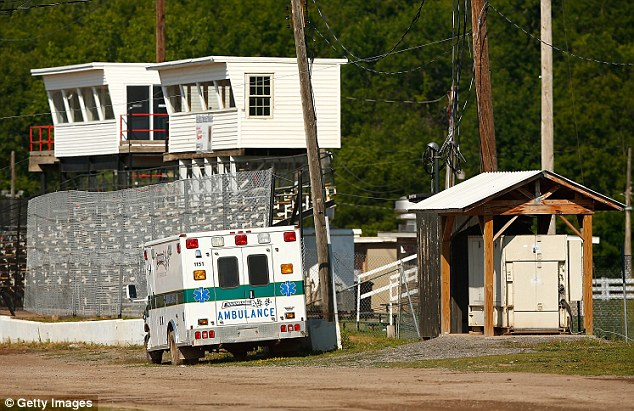 An ambulance is pictured parked on the infield of Canandaigua Motorsports Park on Sunday