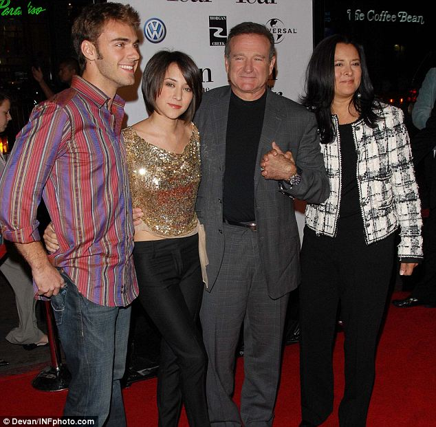 Here, Williams, Garces and their children attend Universal Pictures' World Premiere of Man of the Year held at Grauman's Chinese Theatre in Hollywood