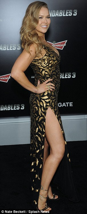 Athletic types: The Expendables 3 star Ronda Rousey, left, and New Zealand stuntwoman Zoe Bell lent their beauty to the premiere