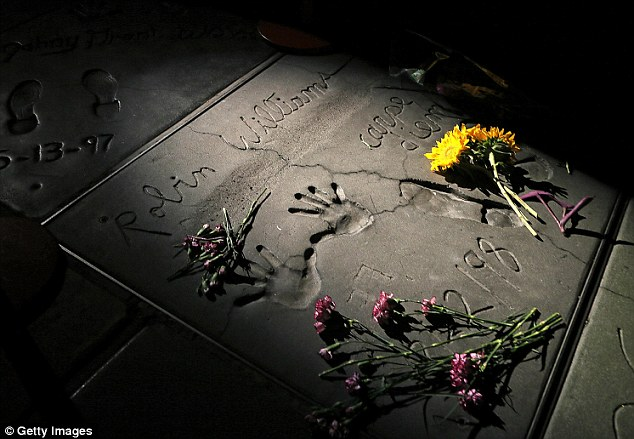 Tribute: A single spotlight shines on the hand and footprints of actor Robin Williams during a ceremony to honor him at the TCL Chinese Theatre on August 12, 2014 in Los Angeles