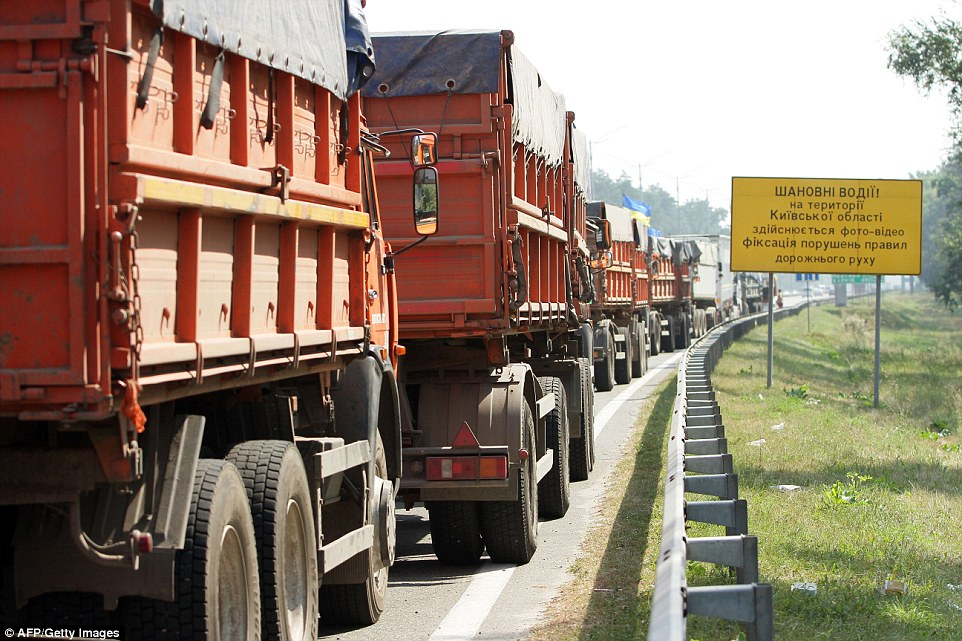 Rolling: The Ukrainian government dispatched its own convoy as tensions rose over the destination - and cargo - of the 262 Russian trucks