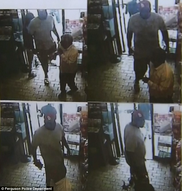 Ferguson police on Friday released these surveillance images which showed two men stealing a $50 box of cigars from a convenience store shortly before midday last Saturday