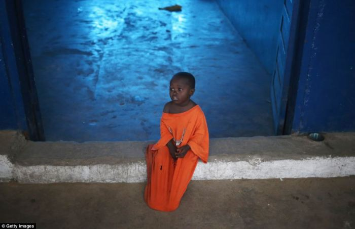 Three-year-old Nino sits in a newly opened Ebola isolation centre set up by the Liberian health ministry in a closed school
