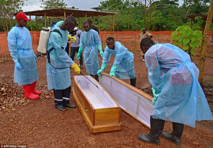 The team then spray the coffin with disinfectant at the facility set up by Medecins Sans Frontieres (Doctors Without Borders)