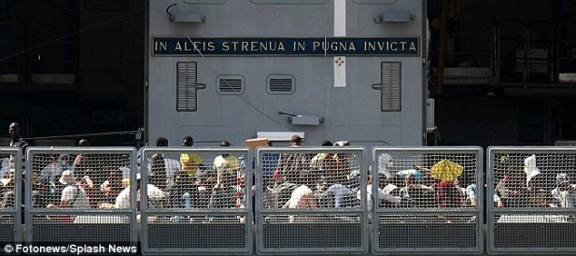 More than a thousand migrants disembark at the port of Naples having fled Africa