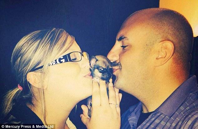 Ashley (foto com o parceiro Ray) diz que quando chegou pela primeira vez em casa, Turbo não foi capaz de fazer muito, mas tem crescido agora em um filhote de cachorro divertir-se