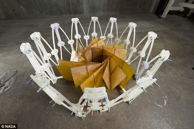 Nasa's solar array has a diameter of 8.9ft (2.7 metres) when folded and 82ft (25 metres) when unfurled.The design, which looks like a flower blooming, was created by Nasa mechanical engineer, Brian Trease