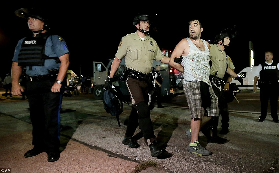 The relatively peaceful protests eventually turned nasty on the streets of the St. Louis suburb after police in riot gear and gas masks formed a barricade and stood watch over the protesters for almost two hours