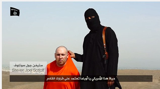 Disgusting: After the death of James Wright Foley, the ISIS representative parades TIME reporter Steven Joel Sotloff in front of the camera