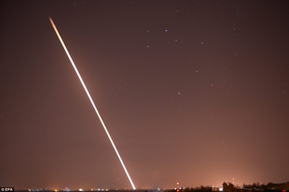 A rocket fired by Palestinian militants inside the Gaza strip rises into the night sky - one of more than 50 fired once the ceasefire was shattered
