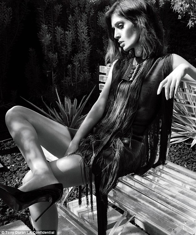 High fashion: In the vampy b&w spread - shot by Tony Duran - the True Blood actress rocks razor-sharp cheekbones alongside a Lanvin fringe frock and Louboutins