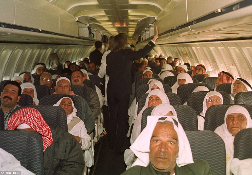 Palestinian pilgrims sit on an aircraft waiting for the departure of their flight from Gaza airport to Mecca in Saudi Arabia in 2001