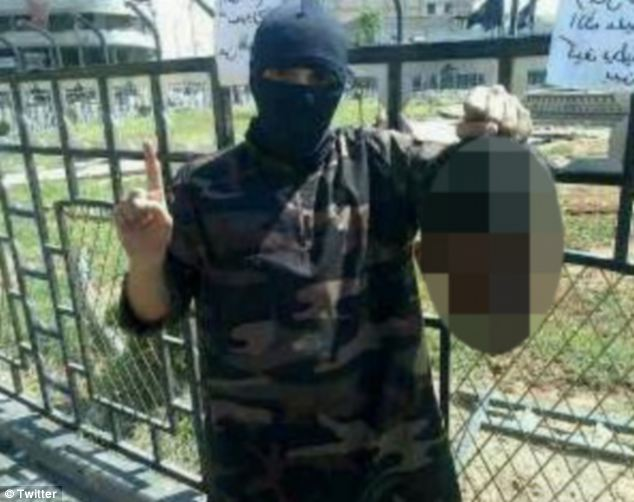 Potential match: Bary, 23, pictured holding a severed head, is reportedly in Syria. According to an expert, his voice and speech patterns are very similar to those of the masked man speaking in the brutal video