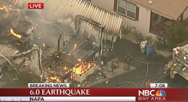 Gas leaks caused by the earthquake set off several fires in the area, including this blaze which broke out at a Napa mobile park and engulfed four homes