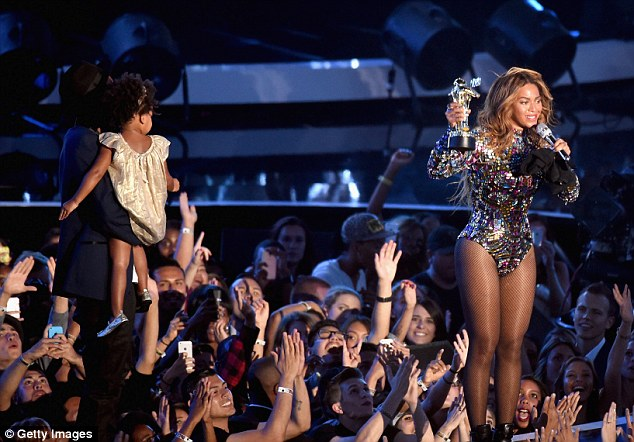 They're coming! Jay Z carried Blue onto stage, while Beyonce delivered her thank you speech while dressed in a dazzling bodysuit