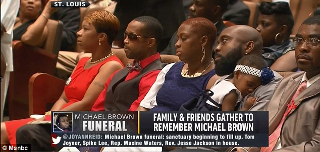Saying goodbye: Michael Brown's family sit together at the service to remember their loved one