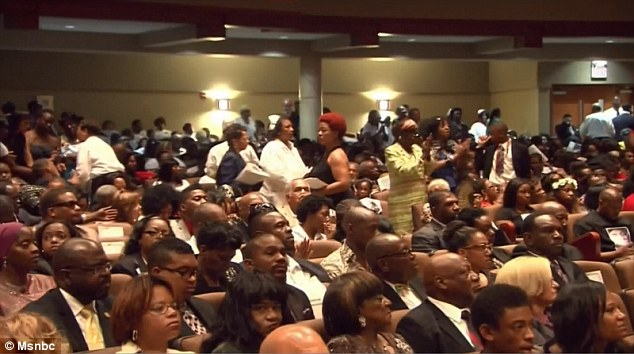 Crowded: Hundred of people crammed into the humble St. Louis church on Monday
