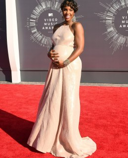 Mama mia: A very pregnant Kelly Rowland was glowing head to toe in her pearly empire waist gown