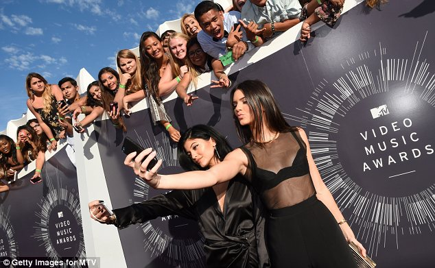 Posing up a storm: Kendall and Kylie Jenner couldn't resist snapping some pictures of themselves on the MTV VMAs red carpet on Sunday