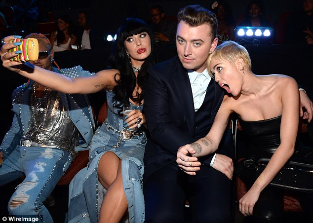 Sam Smith sandwich: Katy and Miley made funny faces as they posed for pictures with Sam